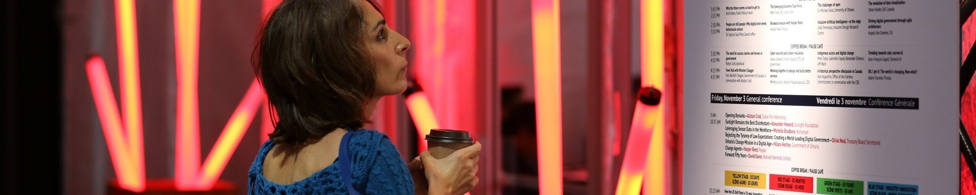 Attendee looks at the FWD50 schedule